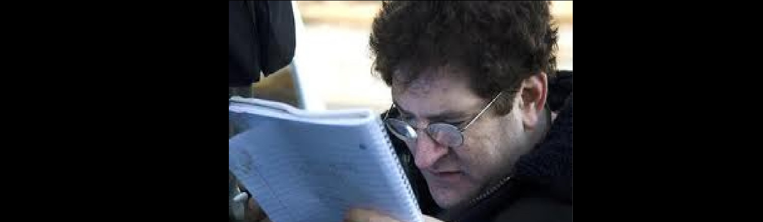 Picture of David reviewing a script