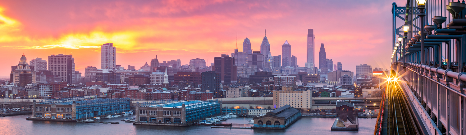waterfront view of Philadelphia at sunset